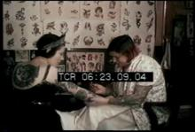 12567_female_tattoo_artist.mp4